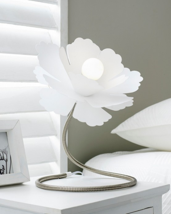 a white flower-shaped table lamp of metal with a large lampshade is a creative addition to a bedroom