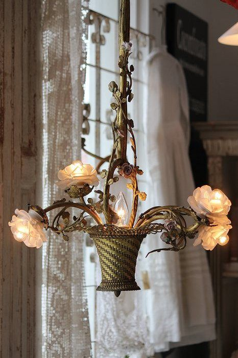 a whimsical floral chandelier with a basket and blooms that function as lights is a very chic idea
