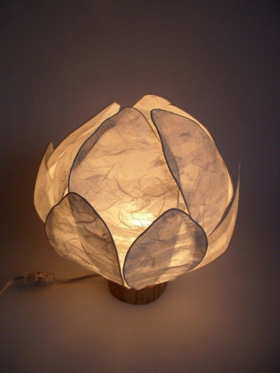a small and simple neutral flower-shaped lamp will bring some peaceful deem and a natural feel to your space