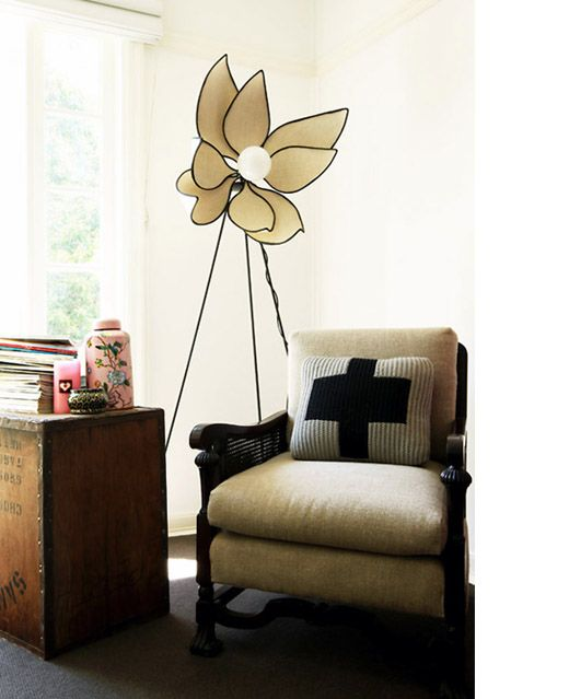 a large flower-shaped floor lamp will bring an unusual feel to your space and will make it look cool
