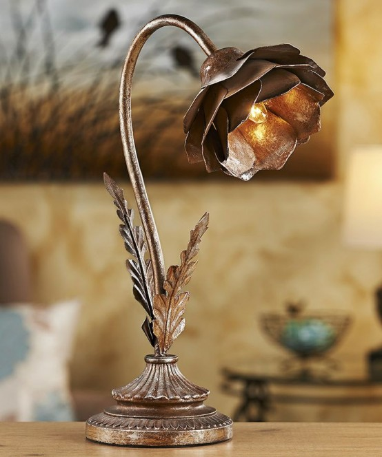 a metal flower-shaped table lamp looks industrial and vintage, with a creative and really unusual look