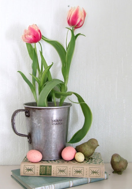 an oversized galvanized mug with some bright tulips is a pretty decoration for spring and Easter that you can make very fast
