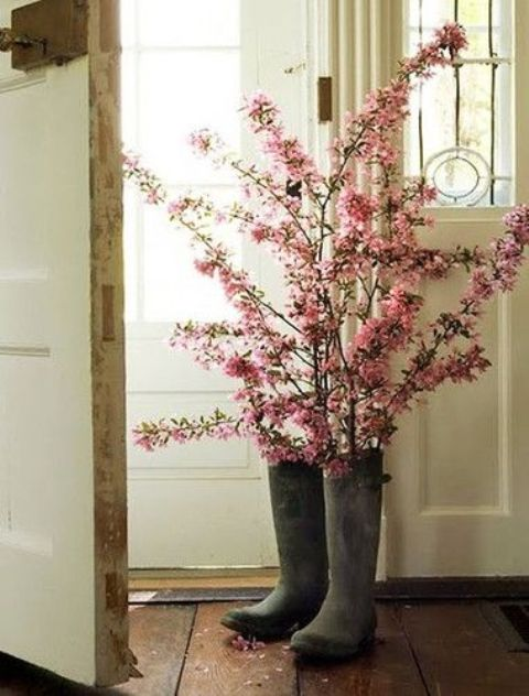 tall rubber boots with pink cherry blossom is a lovely idea for a spring space, it will bring a strong rustic and sprign feel to outdoors or indoors