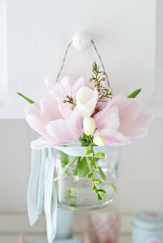 a clear jar with pink and white tulips can be used as an arrangement, centerpiece and even suspended somewhere like in this pic