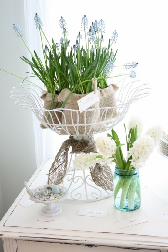 a wire stand with blue hyacinths in burlap is a cool spring decoration or a tall centerpiece to rock