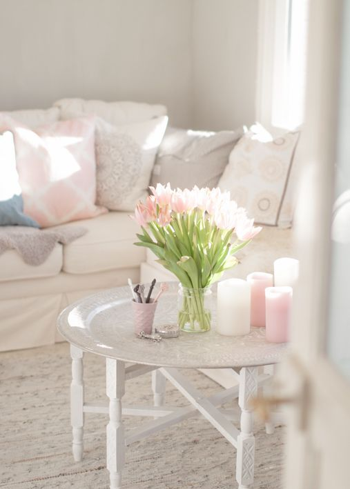 a simple clear jar with pink tulips, pink candles around will give a strong spring feel to the space and will make it lovely