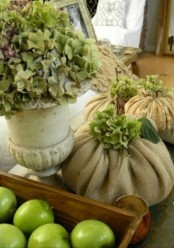 green apples, green hydrangeas, a vintage urna nd burlap sacks for a rustic Thanksgiving table or just decor