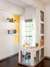 a touch of sunny yellow paint on the wall, a yellow glass and some grass in a glass for a spring feel in the space