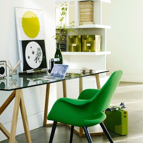 green boxes and an artwork plus a bright green chair bring a spring-like feel to the home office