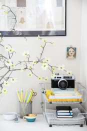 blooming branches in a vase will make your home office flourishing and very fresh