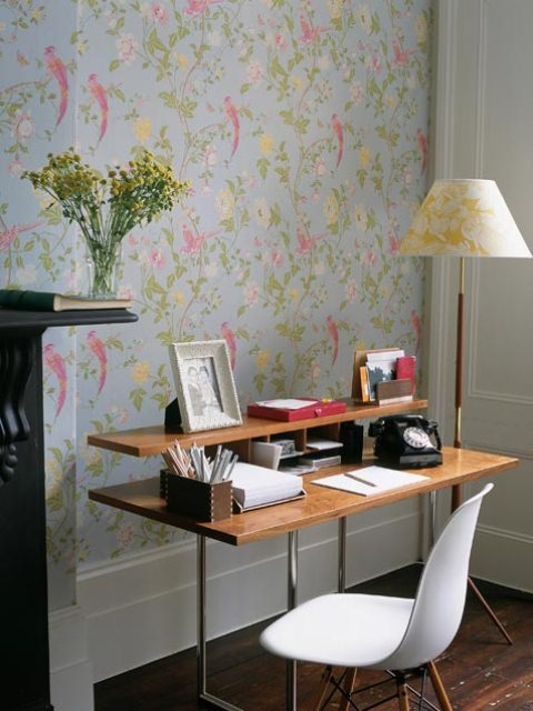 a bright botanical print wall, some blooms in a vase and some bright pink touches for a spring feel in the home office