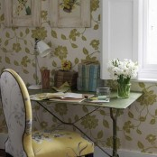 white and green botanical wallpaper and a floral print chair for a chic spring-like look in the home office