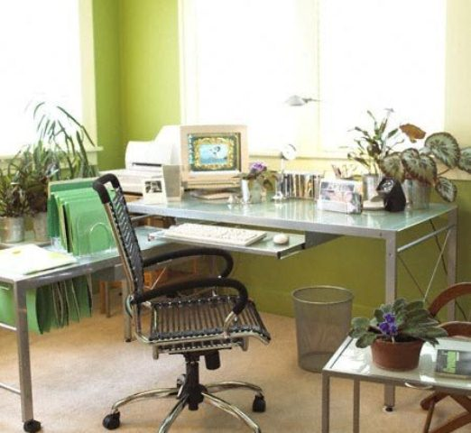 green walls, bright green folders and a mint green glass table refresh the look of the home office
