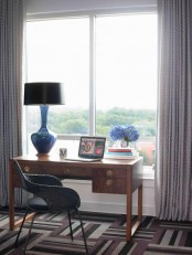 a blue lamp and blue hydrangeas in a vase will refresh any working space and will make it spring-like