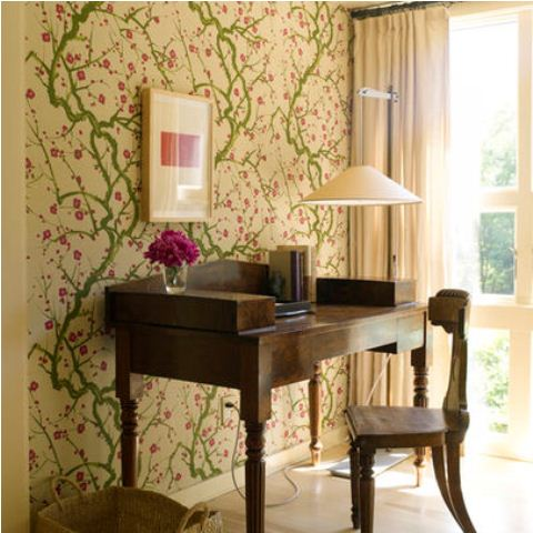 a bright green and pink floral print wall as a cool spring statement and a girlish touch to the office