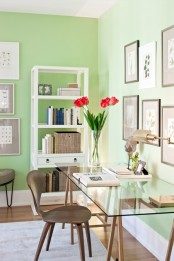 bright green walls and some fresh tulips make the space feel like spring and make it welcoming and bright