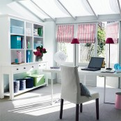 bright striped Roman shades and bright blue touches make this neutral home office super bright and spring-like