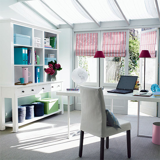 bright striped Roman shades and bright blue touches make this neutral home office super bright and spring like