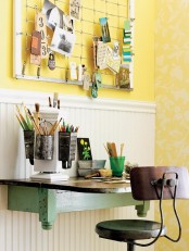sunny yellow wallpaper, a mint green floating desk and some bright colored pencils and pens add a spring feel to the space