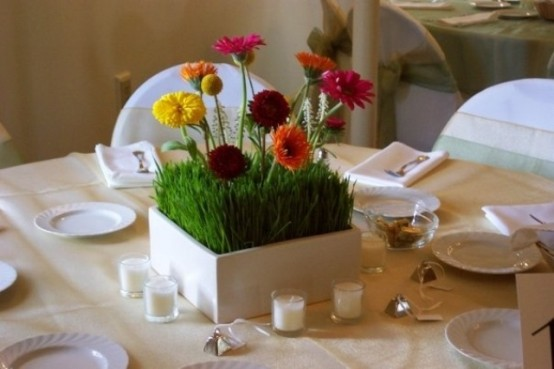 a white box planter with wheatgrass and bold blooms can be used as a spring centerpiece, candles will add to it