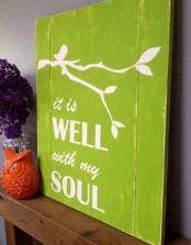 a bright green sign with branches and a bird plus some tenciled letters is a colorful and bold idea for spring