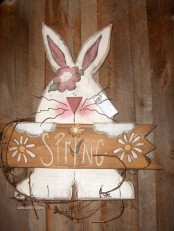 a fun spring sign with a bunny holding a sign is a simple creative idea for decorating your space with a bit of cuteness