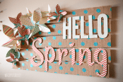 a bright spring sign with burlap polka dot ribbons, fabric and cardboard letters and paper flowers
