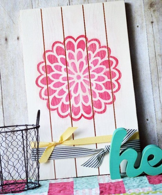 a simple and cute soring sign with a pink bloom stenciled plus some ribbons is a lovely idea for spring or summer
