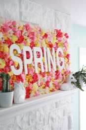 a creative spring sign made of bright faux blooms and some letters is a fantastic idea for your mantel