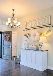 a large vintage spring sign made of an old window frame is a cool idea for a classic farmhouse or a vintage rustic space