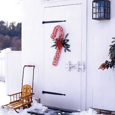 a bright red and white ribbon candy cane wreath will accent your door at its best and will make your space whimsical and fun