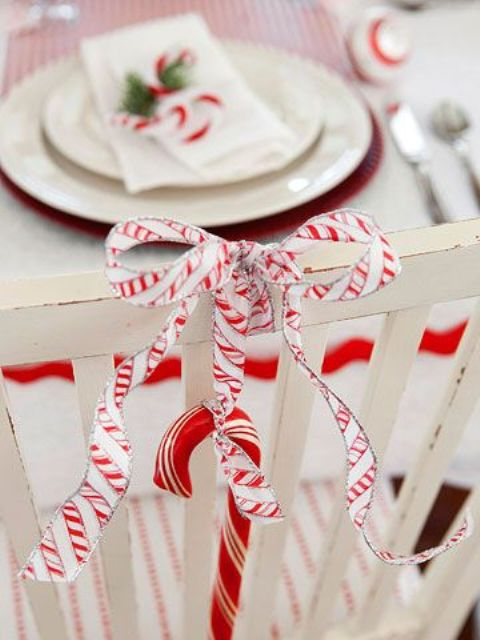 accent your chair with a candy cane and a ribbon bow to make it look cool and bright