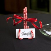 a candy cane stand with a red bow and a card is a pretty and cool decor idea for the holidays, make it yourself