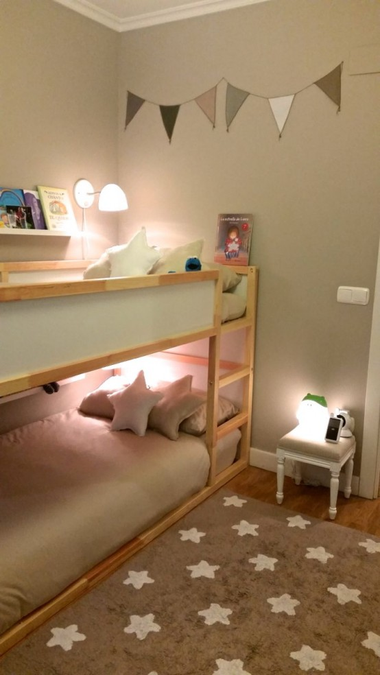 aneutral wooden bunk bed unit with wall lamps and a ladder attached for a natural touch in the room