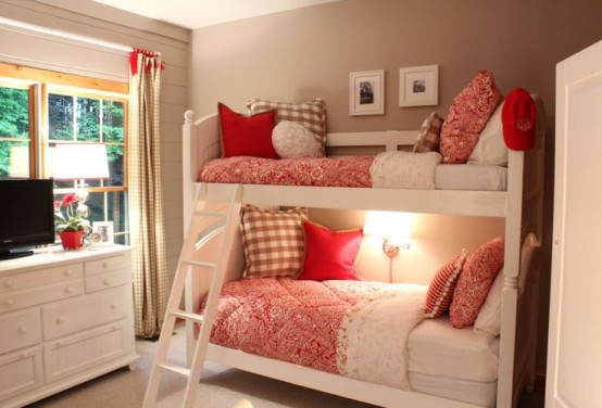 a tiny and cozy white bunk bed unit with a ladder and a single wall lamp over the lower bed for a welcoming bedroom