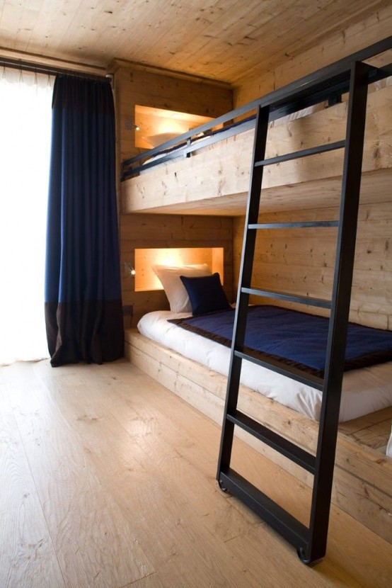 a wood clad bunk bed setup with built-in lights and wiht a metal ladder looks veyr contemporary and inviting