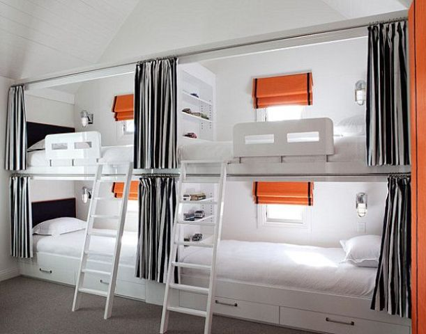 a functional kids' bunk bed setup done in white, greys and with orange accents, with ladders and lights