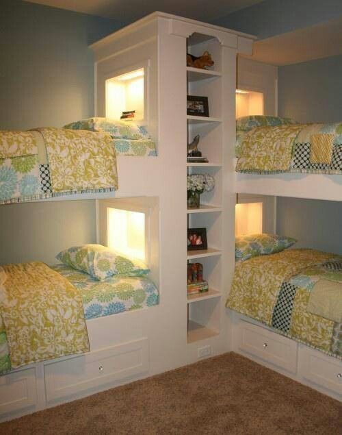 a unk bed unit for four with a built in storage unit and built in lights plus storage drawers in the lower beds