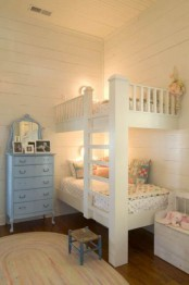 vintage built-in white bunk beds, wall sconces and an integrated ladder to go to the upper part