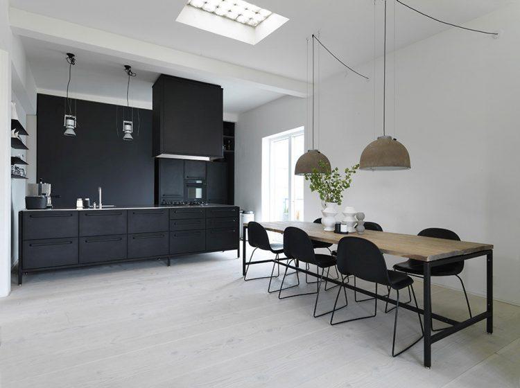 modern kitchen with black cabinets and a black backsplash