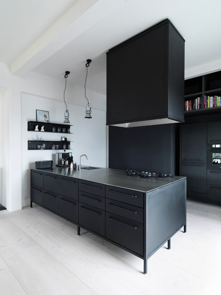 even a kitchen island with a cooking hood above it are all black
