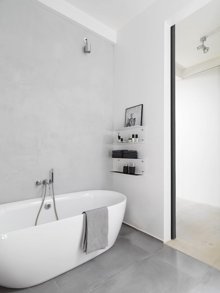 almost pure white bathroom with minimalist looking open shelving