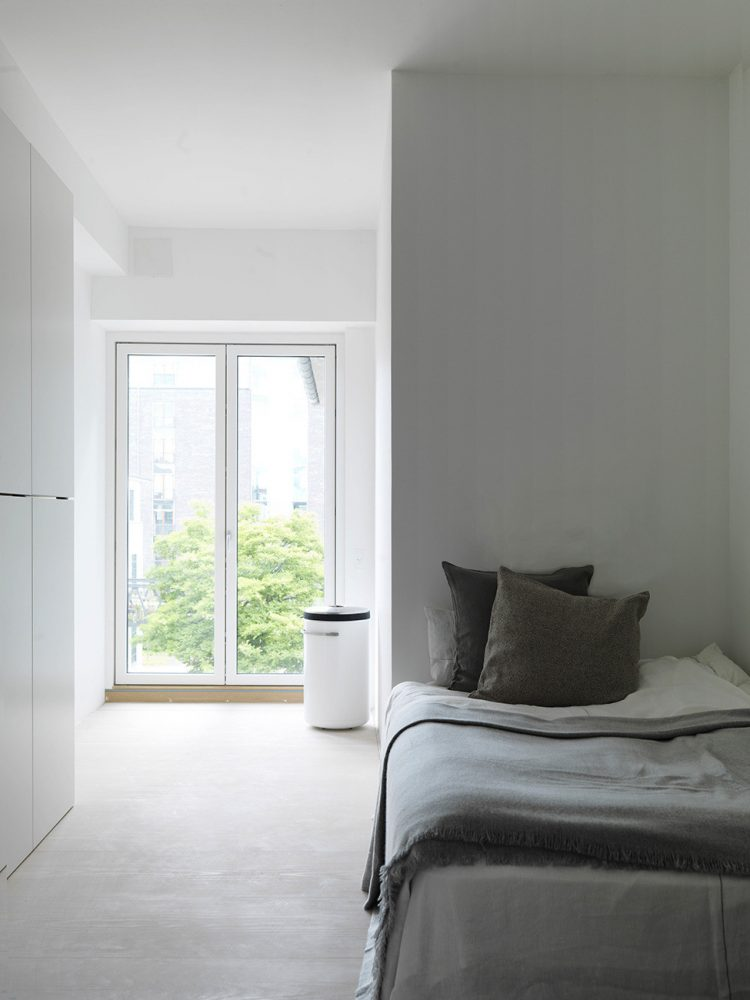 like in many Scandinavian interiors, this bedroom is quite minimalsit