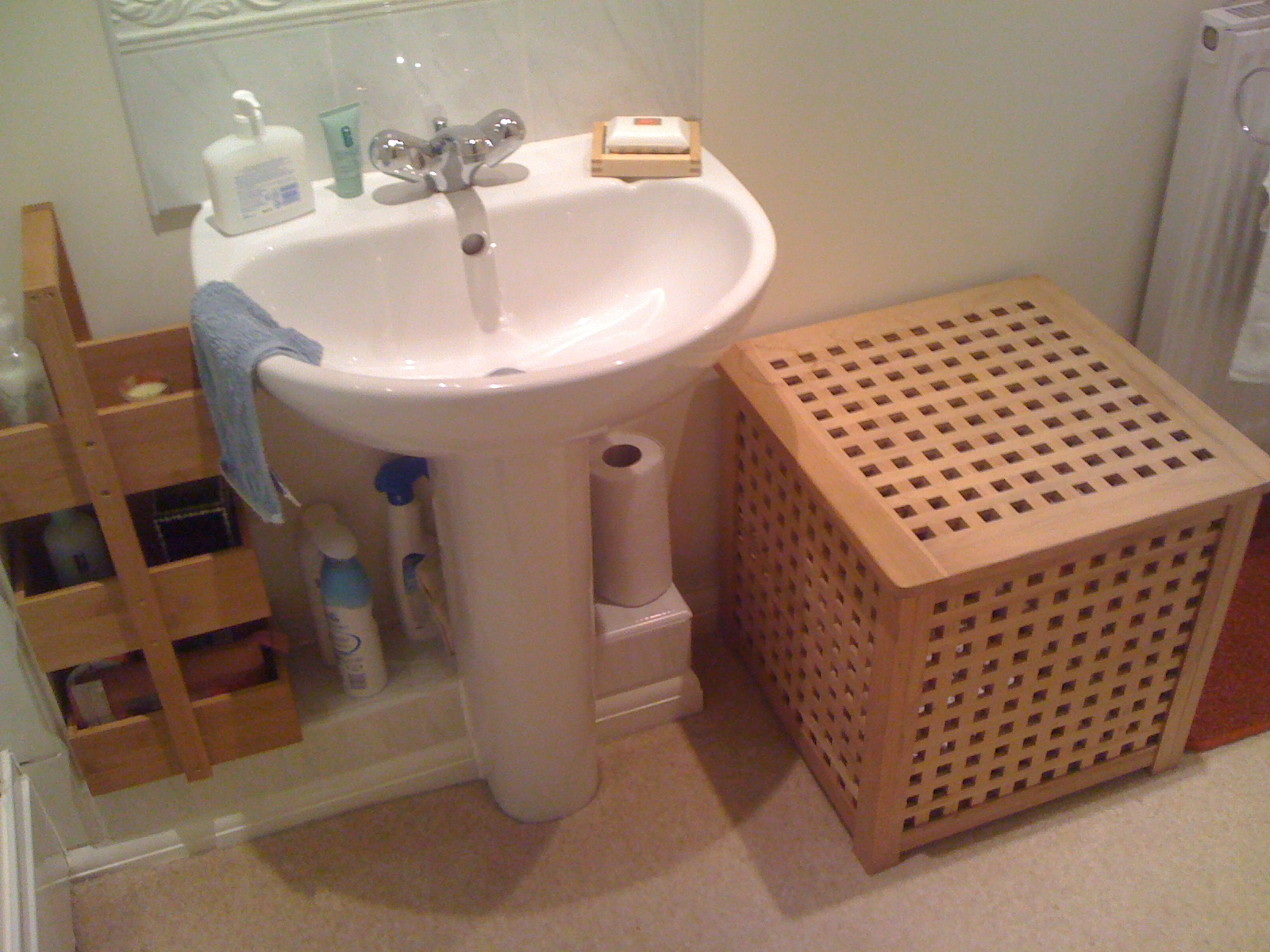a small IKEA Hol table used in the bathroom to store things inside and outside too