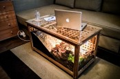 an IKEA Hol table transformed into a turtle terrarium with light, it doubles as a coffee table in the living room