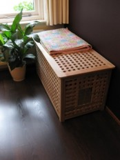 an IKEA Hol table as a hidden pet bed or loo can be placed anywhere and the inside will be more or less hidden