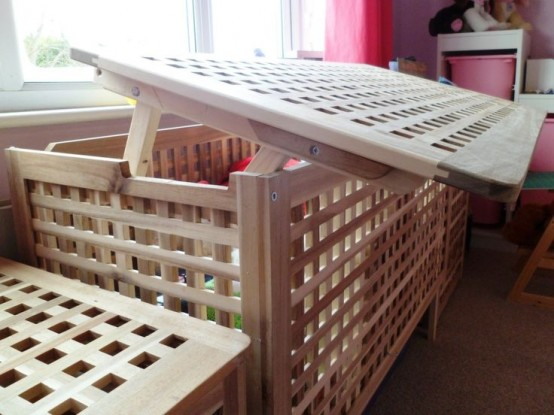 an IKEA hol table used in the nursery for storign toys and other kids' stuff is a cool idea with a casual feel