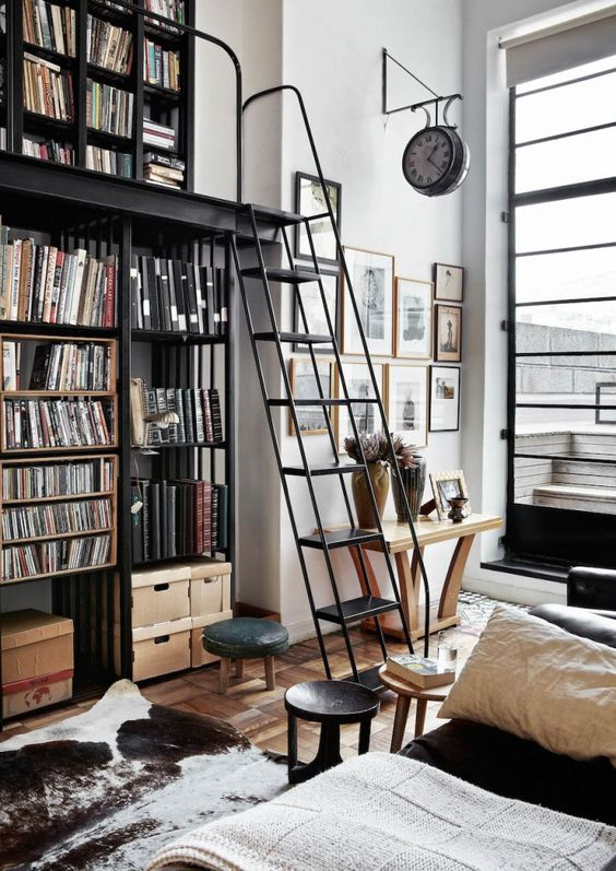 "The steel bookcase with ladder is both functional and a signature piece; the Victorian clock underlines the ""public space"" feel"