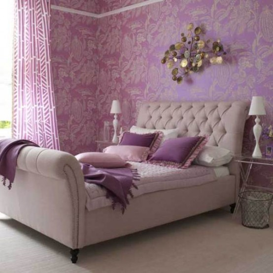 a lilac, purple, gold glam bedroom with a refined upholstered bed, cool textiles, a chic sculpture on the floor