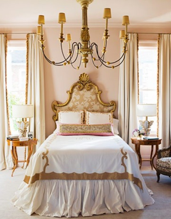 a refined neutral bedroom with classic chic and gold touches, exquisite furniture and lamps
